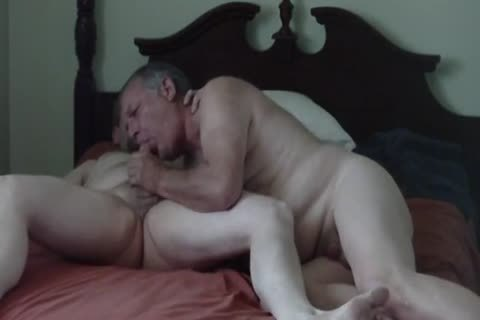 Two daddy Bears on a bed