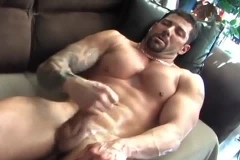 Muscle Lad Plays With A fake penis