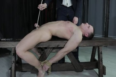wild boy tied Down, Balls Strung Up And Spanked