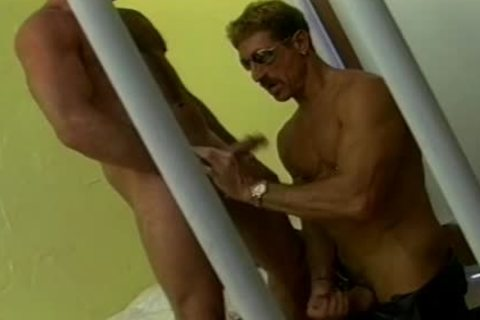 Two Mustachioed guys have a joy A Hard bang In A Jail Cell