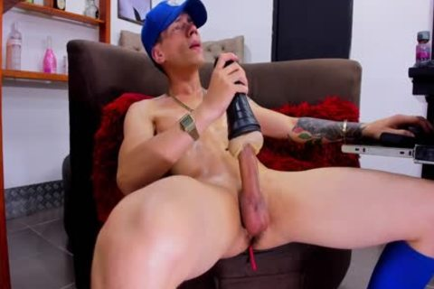youthful athletic boy With Tattos Plays With Fleshjack And sperm