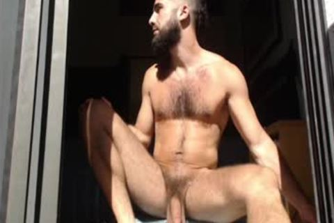 Bearded guy Massages his testicles