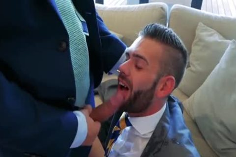 two Suited men pounding