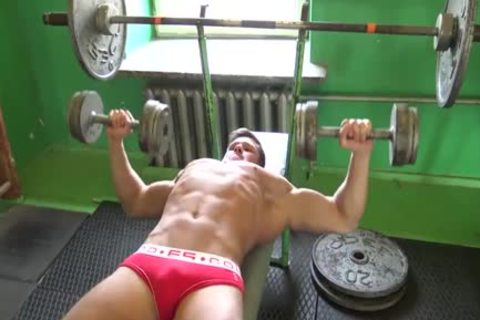 yummy brawny Bodybuilder Trains At Gym